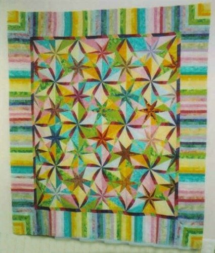 This twisted star becomes real easy once you master how to join the points in the center panel. The border is really simple to make.