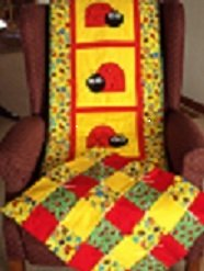 Ladybug wallhanging with doll quilt